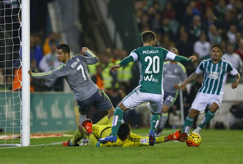 Real Madrid's Cristiano Ronaldo in action next to Real Betis' goalkeeper Antonio Adan
